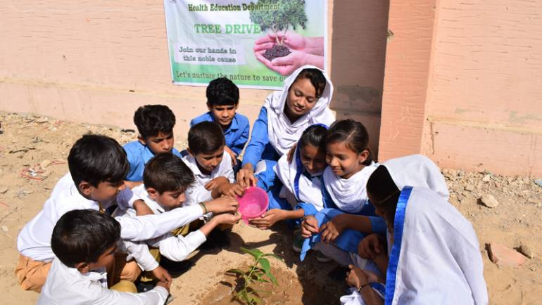 School children eye screening activity and tree plantation